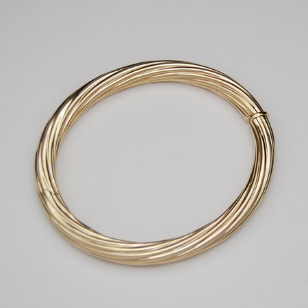 7-Inch 14K Yellow Gold 6.9mm Twisted Bangle